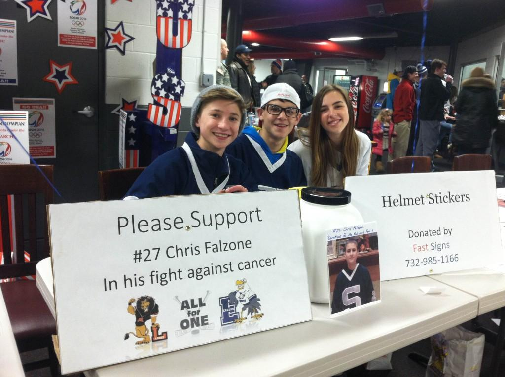 South+students%2C+led+by+Dylan+Curcio+%28right%29%2C+supporting+the+cause+at+the+Hockey+Game+by+encouraging+donations.