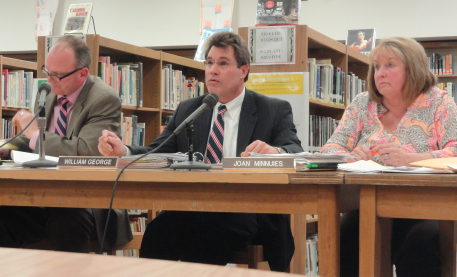 Dr. William George, Superintendent of Schools, at the Board of Education Meeting