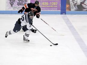 South's Alex Demaio, No. 22, skates past North's Tom Terranova.