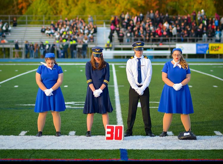 From left to right, Color Guard Captain Isabella Mingino, Junior Drum Major Grace McDonnell, Senior Drum Major Andrew King, Color Guard Captain Danielle Bellia.