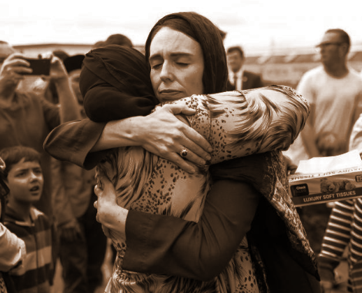 New Zealand Prime Minister Jacinda Ardern hugging comforting a woman after the Christchurch Mosque shootings