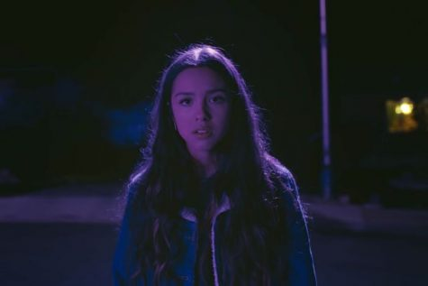 "The Trend: Olivia Rodrigo's song ""Drivers License""   Where you've seen it: Tik Tok, Instagram, Twitter, Spotify, Apple Music  The Backstory: The song's release has led people to believe that the song is about the 18-year-old singer's relationship with her co-star Joshua Bassett from High School Musical: The Musical Series. Speculations first started on January 4th, when Olivia announced the release of her song. About an hour later, Joshua announced the release of his upcoming single ""Lie, lie, lie."" Olivia and Joshua were rumored to be dating within the past year, but neither publicly confirmed the relationship. Breakup rumors began surfacing in the summer of 2020, when Olivia posted a TikTok where she says, ""You think you can hurt my feelings?"" and captioned the video, ""And that's on failed relationships.""  Around this time, photos began surfacing of Joshua and Sabrina Carpenter on a date, sparking dating rumors.   In ""Drivers License,"" Olivia sings about a blonde girl who is much older than she is; Sabrina is both blonde and four years older than Olivia. Olivia also sings, ""Guess you didn't mean what you wrote in that song about me,"" and fans have speculated that Joshua's 2020 song ""Anyone Else"" is about Olivia. Lastly, and probably the most important clue of all, Olivia shared that Joshua was the person to teach her how to drive--which might be why the song is called ""Drivers License.""   ""Drivers License"" is cutting through the muck of 2021 in a major but simple way. That's because the song is of this specific moment. For American teenagers during the pandemic, everybody can somehow relate to this song whether it"